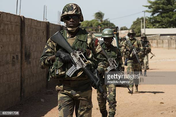 ECOWAS troops patrol in the streets of Barra town after the former President Yahya Jammeh left the country in Banjul Gambia on January 22 2017 Yahya...