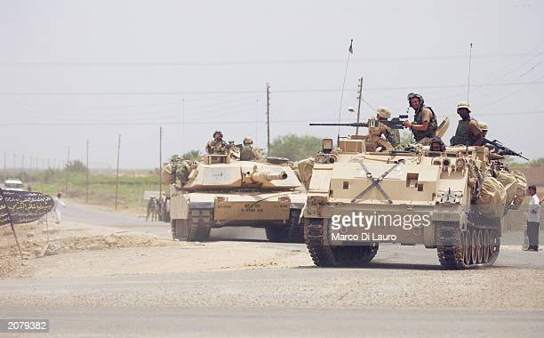 Troops patrol the streets following a military operation in which coalition forces detained over 400 suspects and confiscated numerous weapons and...
