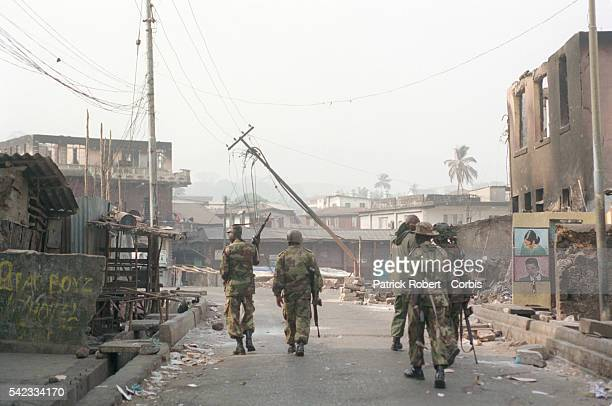 ECOMOG troops patrol the town that has been devastated