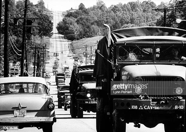 US troops patroling streets during riots vs enrollment of African American James H Meredith at Univ of Mississippi