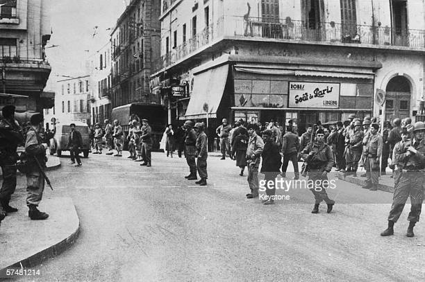 Troops patrolling the town hall area in Oran during the Algerian crisis 1st February 1960
