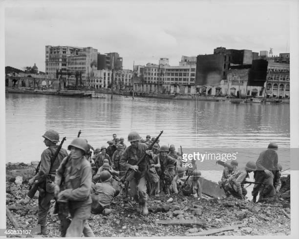 US troops preparing to launch an amphibious attack on the walled city of Manila during World War Two Philippines February 26th 1945