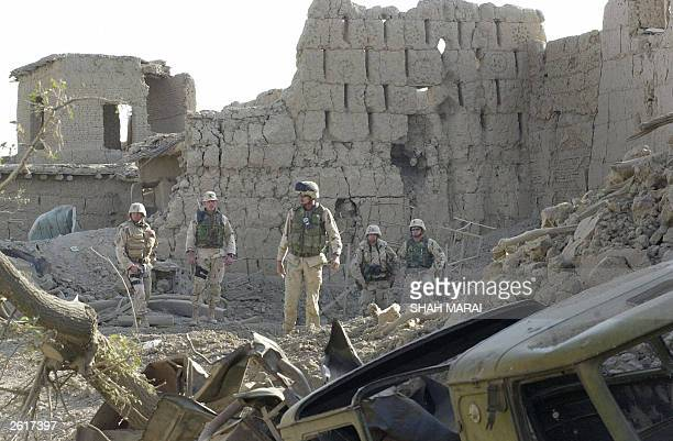 US troops search through the rubble of a house destroyed in an explosion in the village of QalaeGulai near the USled coalition's Bagram Air Base...