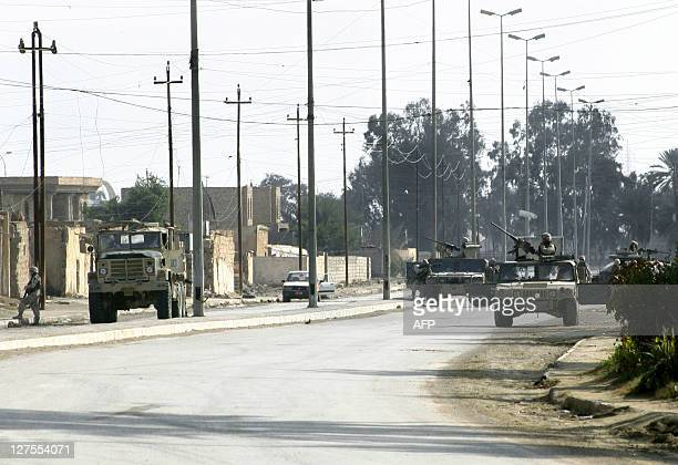 US troops secure an area in Ramadi 100km west of Baghdad after an Iraqi civilian died and six others were wounded when insurgents opened Kalashnikov...