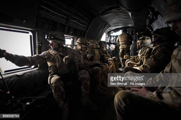 Troops sit onboard a Sea King helicopter and head towards Forward Operating Base Pimon as part of the Joint Helicopter Force's daily task of vital...