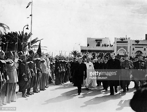 Troops stand to attention as the French Premier, Edouard Daladier , conducts an inspection at Sousse, in Tunisia, as part of his tour of the French...