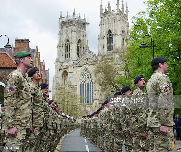 Troops stand to attention in front of York Minster as over 300 soldiers marched through the city streets on May 24, 2013 in York, England. The...