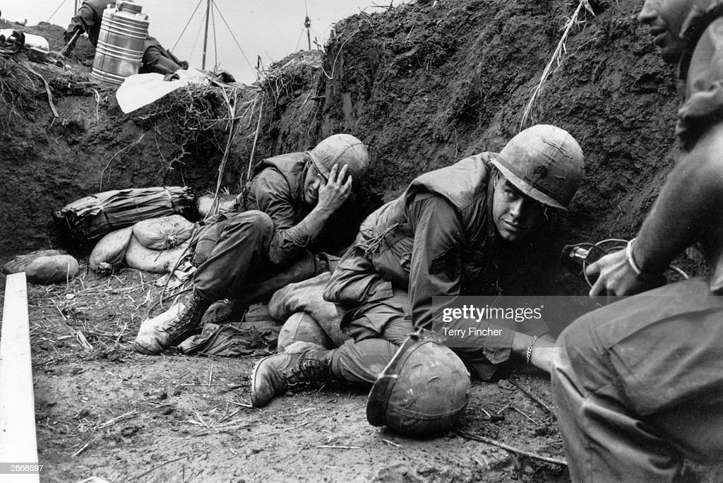 US troops take cover from the Vietcong in a trench on Hill Timothy, during the Vietnam War.