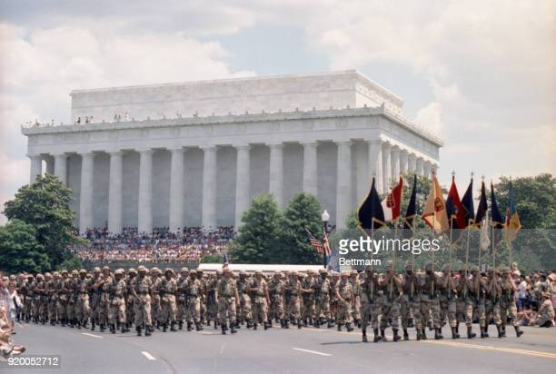 Troops that participated in Operation Desert Storm march past the Lincoln Memorial in the nations capital during a victory parade.