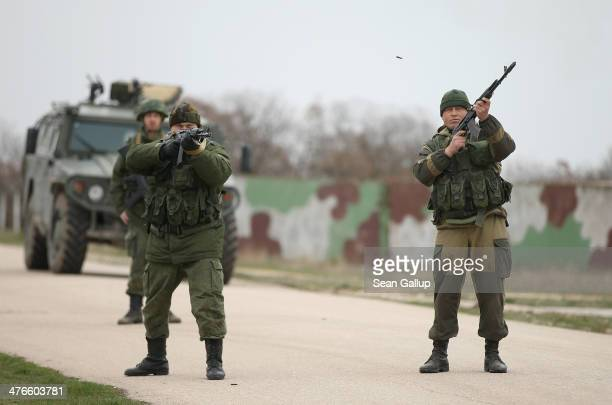 Troops under Russian command fire weapons into the air and scream orders to turn back at an approaching group of over 100 hundred unarmed Ukrainian...