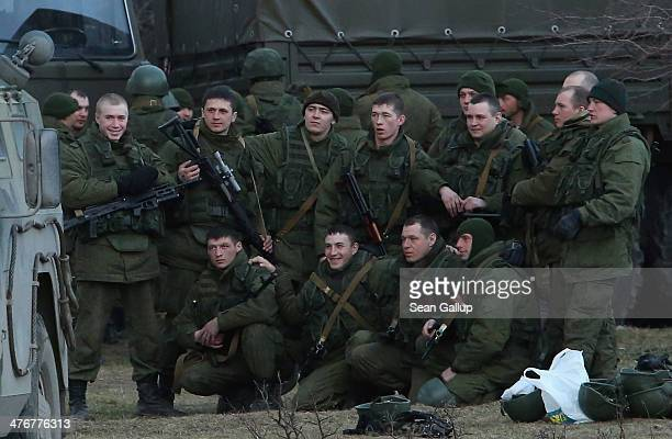 Troops under Russian command pose for a group photo before getting into trucks near the Ukrainian military base they are blockading on March 5 2014...