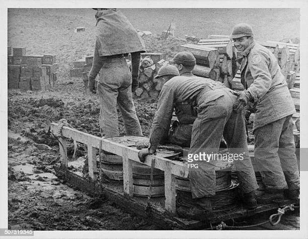 US troops unloading supplies as they try to take Kiska from Japanese forces during World War Two Aleutian Islands Alaska circa 1943