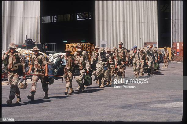 S troops walk along January 23 1994 as they withdraw from Mogadishu Somalia In early December 1992 the UN approved a large scale deployment of about...