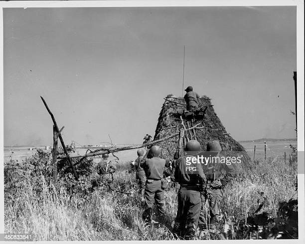 Troops with the 45th Infantry Division at a makeshift observation point, World War Two, Italy, May 29th 1944.