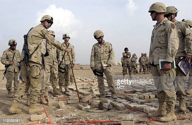 US Troops with the First Infantry division are briefed on the battle plan in Fallujah Iraq Tuesday November 9 2004