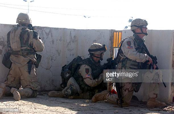 US troops with the First Infantry division battle insurgents in Fallujah Iraq Tuesday November 9 2004
