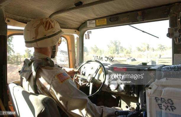 Troops with the US Army 3rd Infantry Division 2nd Brigade Combat Team patrol in Humvee vehicles June 27 2003 in a village east of Fallujah a city...