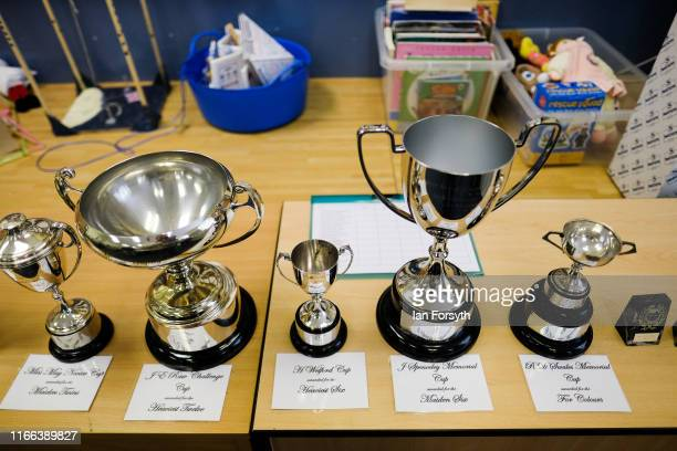 Trophies are displayed out as judging takes place during the annual Egton Bridge gooseberry show on August 06 2019 in Whitby England The gooseberry...