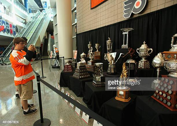 NHL trophies are on display during the Fan Fest as part of the 2014 NHL Entry Draft at the Wells Fargo Center on June 27 2014 in Philadelphia...