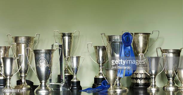 trophies in cabinet - trophy stock pictures, royalty-free photos & images