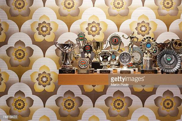 trophies on a shelf - trophy stock pictures, royalty-free photos & images