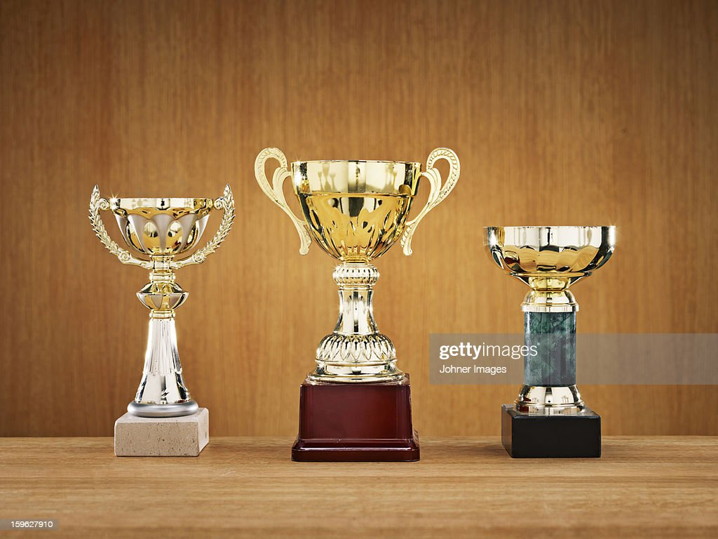 Trophies on wooden background : Stock Photo