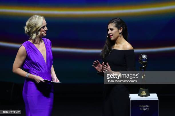 Trophy bearer Carli Lloyd of the United States talks to Amanda Davies on stage during the FIFA Women's World Cup France 2019 Draw at La Seine...
