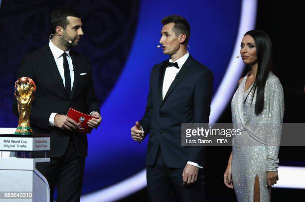 Trophy bearer Miroslav Klose is interivewed on stage during the Final Draw for the 2018 FIFA World Cup Russia at the State Kremlin Palace on December...