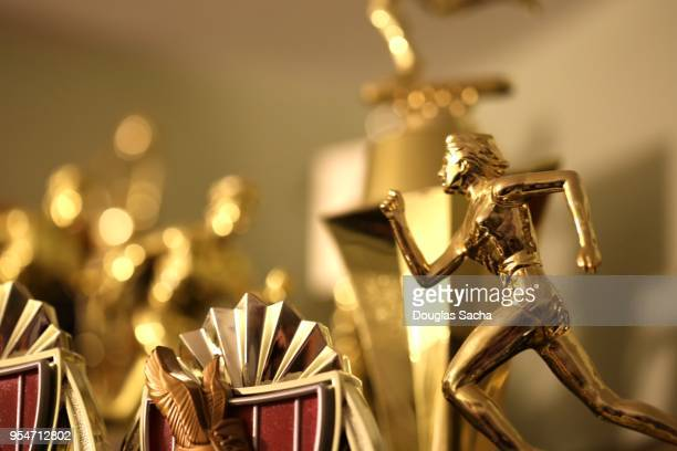 trophy case with a collection of awards - influencer awards stock photos and pictures