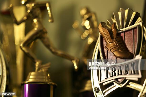 trophy case with awards displayed - american influencer awards stock pictures, royalty-free photos & images