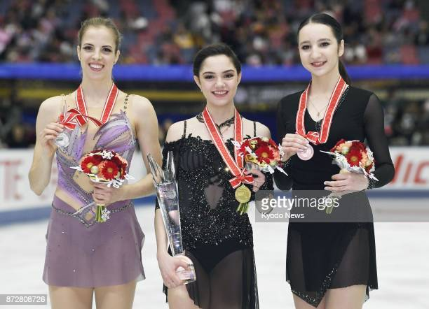 NHK Trophy gold medalist Evgenia Medvedeva of Russia poses for a photo with silver medalist Carolina Kostner of Italy and Polina Tsurskaya of Russia...