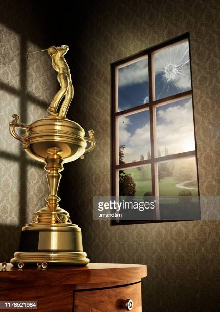 trophy of golfer breaking a window - golf tournament stock pictures, royalty-free photos & images