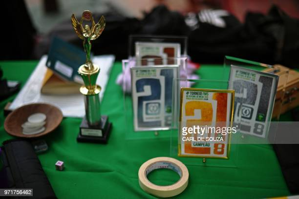 A trophy sits o th table as a game of Button Football is played in Rio de Janeiro on May 19 2018 Every weekend 20 to 30 players meet to play with...