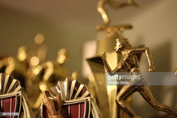 trophy's of success - image awards stock pictures, royalty-free photos & images
