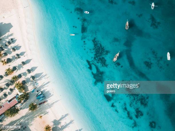 tropic beach of zanzibar with boats - zanzibar stock pictures, royalty-free photos & images