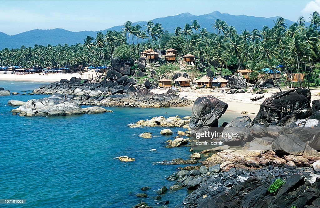 Tropical bay, Palolem beach, bamboo huts, palm trees, Goa, India : Stock Photo
