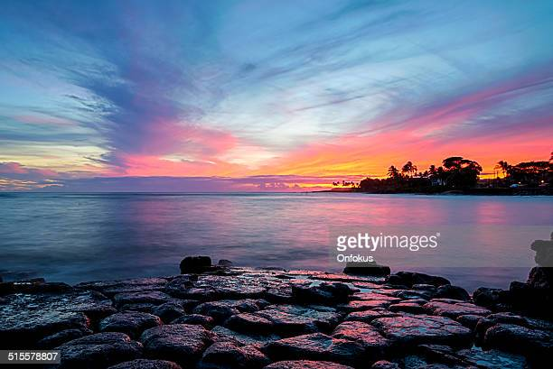 tropical beach and ocean sunset, kauai, hawaii - kauai stock pictures, royalty-free photos & images