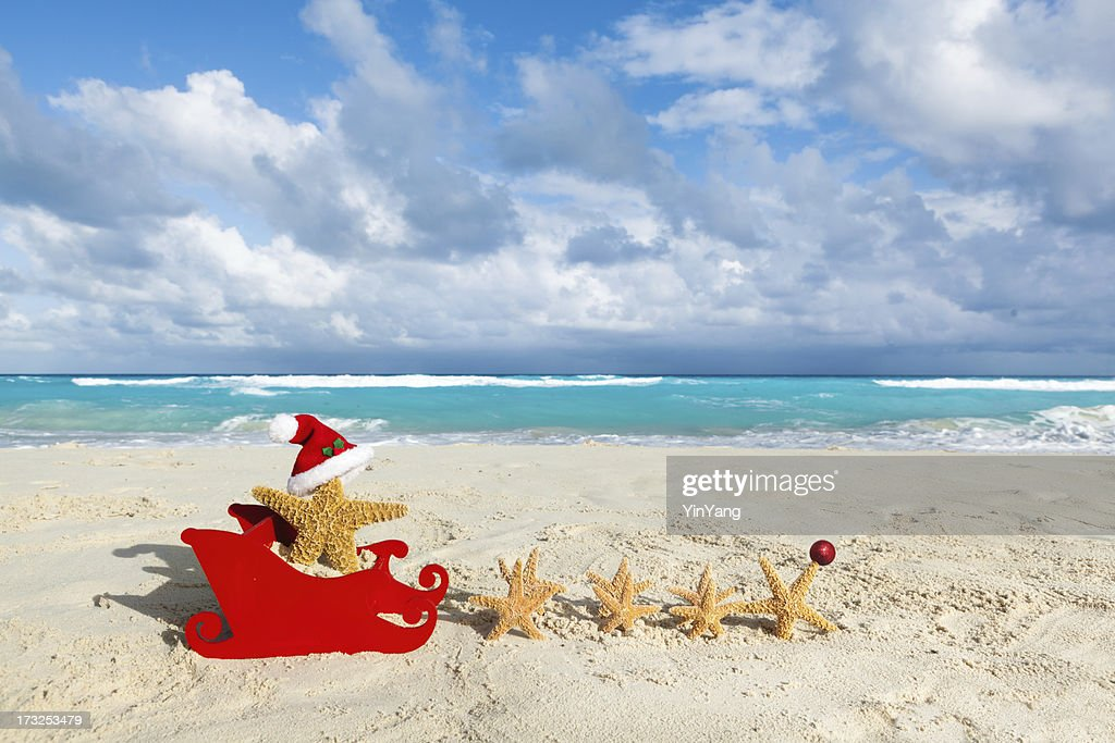 Tropical Beach Christmas Vacation Santa Claus With Starfish And Sleigh Stock Photo