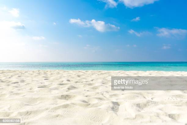 tropical beach sea sand sky and summer day. empty sea and beach background with copy space - elysium stock photos and pictures