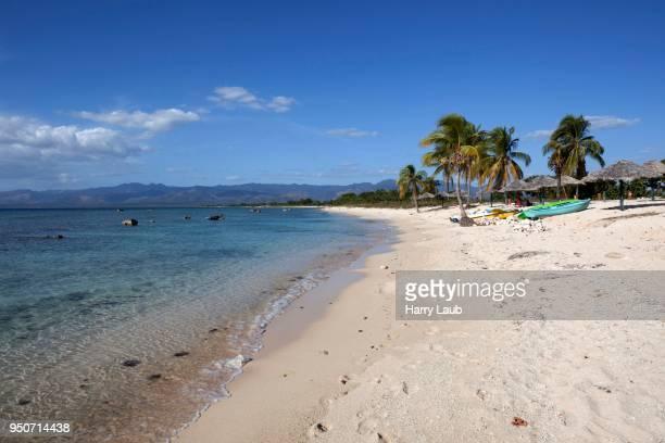 Tropical beach with palm trees at Playa Ancon, near Trinidad, Sancti Spiritus Province, Cuba