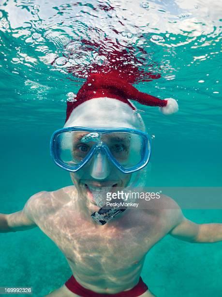 Tropical Christmas Holiday Getaway Snorkeling with Santa Hat