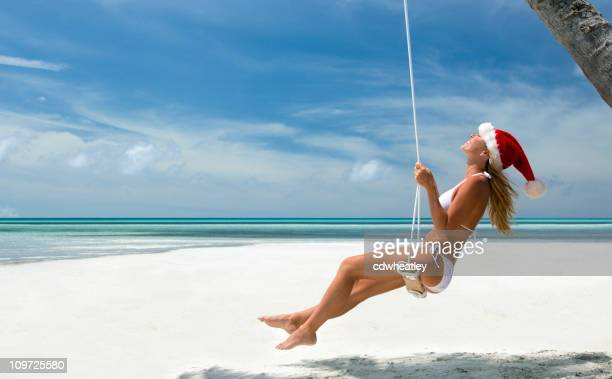 tropical christmas woman on a swing - beach christmas stock pictures, royalty-free photos & images