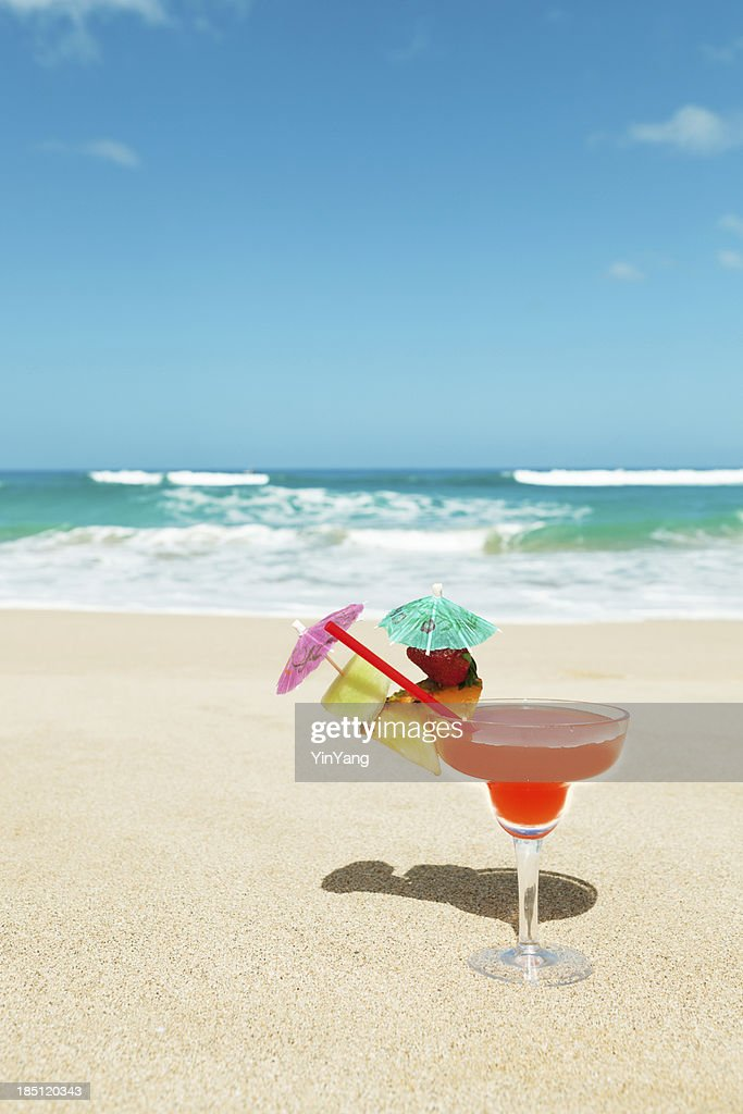 Tropical Cocktail Drink With Umbrella On A Sandy Beach Vt