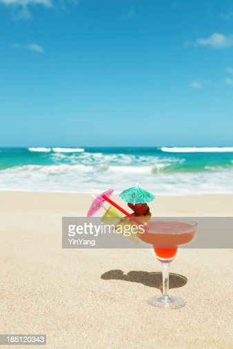 Tropical Cocktail Drink With Umbrella On A Sandy Beach Vt Stock Photo