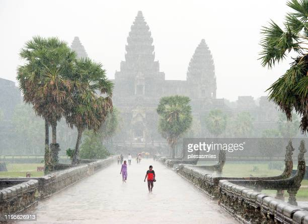 tropical deluge, angkor wat temple complex, siem reap, cambodia. - cambodia stock pictures, royalty-free photos & images