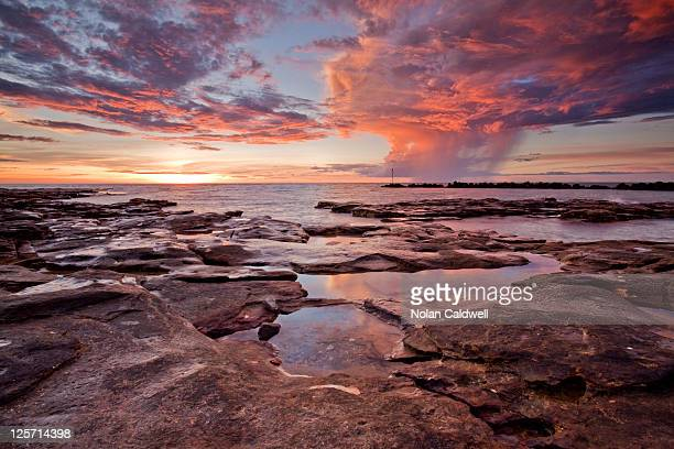 tropical downpour at sunset - darwin australia stock pictures, royalty-free photos & images