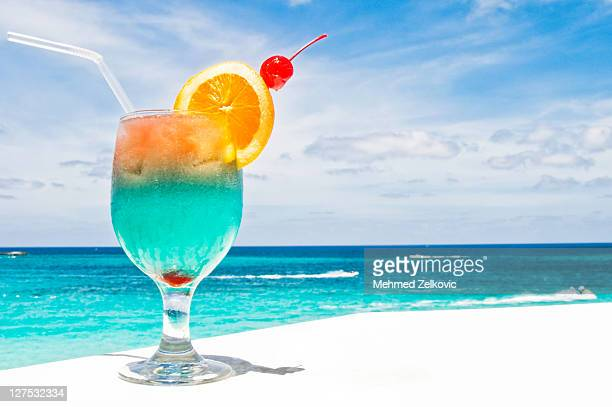 tropical drink on paradise vacation - nassau stock photos and pictures