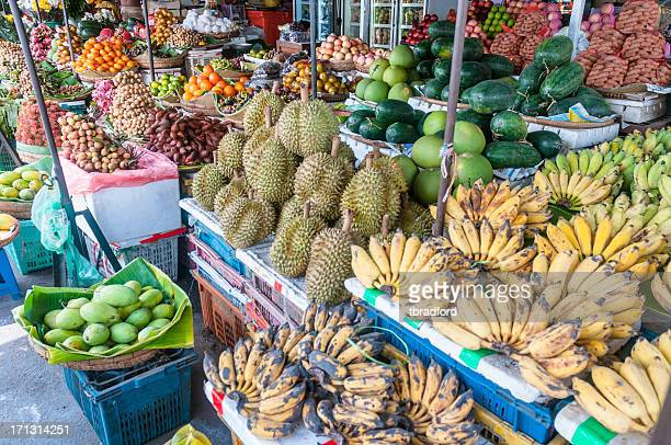 tropical fruit at a street market in phnom penh, cambodia - phnom penh stock pictures, royalty-free photos & images