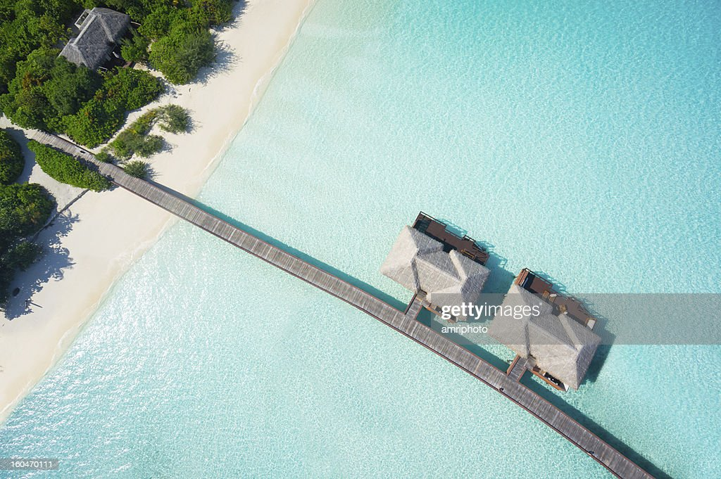 tropical hideaway from above : Stock Photo