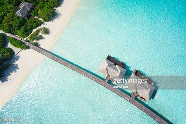 tropical hideaway from above - indian ocean stock pictures, royalty-free photos & images